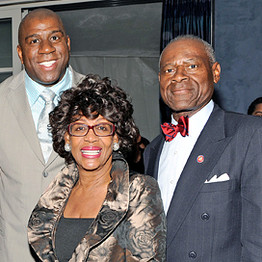 Socializing with Magic Johnson, the kind of socializing that's just fun and doesn't cost HER anything.