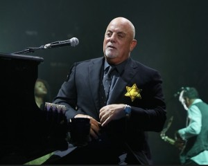 NEW YORK, NY - AUGUST 21:  EXCLUSIVE COVERAGE:    Billy Joel wears a jacket with the Star of David during the encore of his 43rd sold out show at Madison Square Garden on August 21, 2017 in New York City.  (Photo by Myrna M. Suarez/Getty Images)