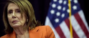 House-Minority-Leader-Nancy-Pelosi-D-CA-looks-on-during-a-bill-signing-event-at-John-Jay-College-May-1-2018-in-New-York-City-e154644728512[1]
